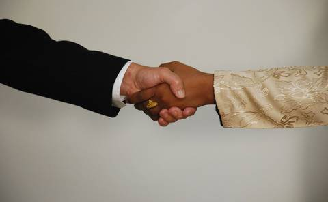 Employer and employee shaking hands.