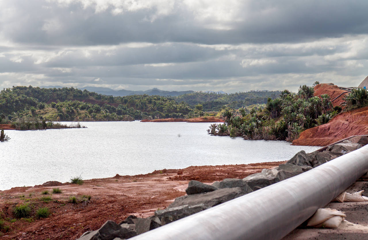Mine tailings reservoir in Madagascar, receiving slurry through a pipeline from an ore processing plant